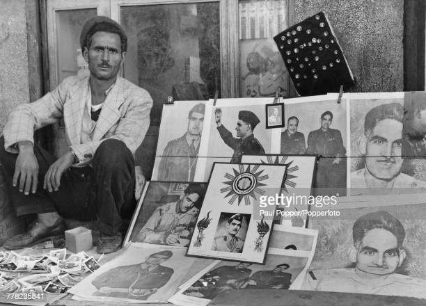 A vendor sellling portraits of Iraqi Prime Minister Abd alKarim Qasim on Rashid Street in Baghdad Iraq circa 1959 Qasim seized power in the 14th July...