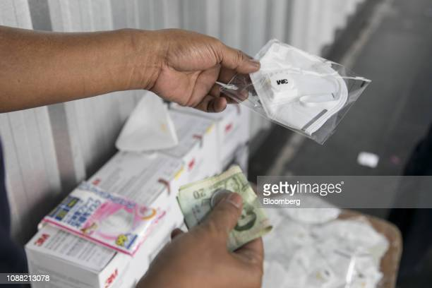 A vendor sells a 3M Co mask in Bangkok Thailand on Friday Jan 25 2019 Outpatient visits at Ladprao General Hospital Pcl hospitals in Bangkok have...