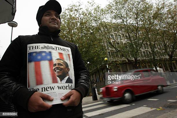 A vendor sells a copy of The Times newspaper featuring Barack Obama on the cover outside the US embassy on November 5 2008 in London Global news...