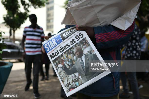 A vendor sells a newspaper with the headline of the death of former Kenya's president Daniel Arap Moi in Nairobi on February 4 2020