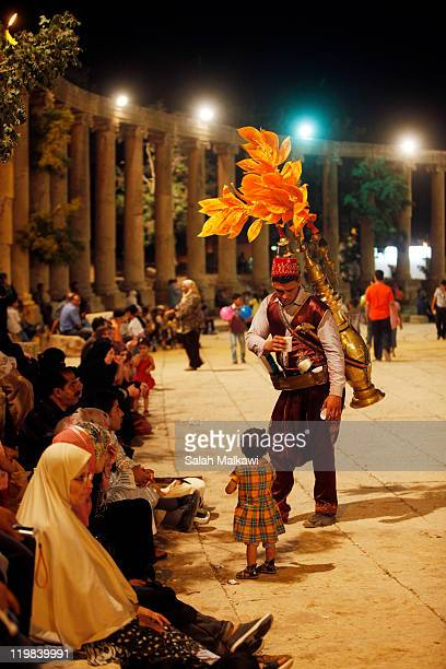 Vendor sells a traditional soft drink called Tamr hindi to fans at the main square during the Jerash Festival on July 24 2011 in Jerash Jordan The...