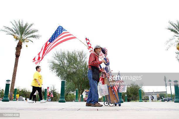 A vendor sells American flags during a a rally for the Tea Party Express national tour October 22 2010 in Phoenix Arizona The tour part of an...