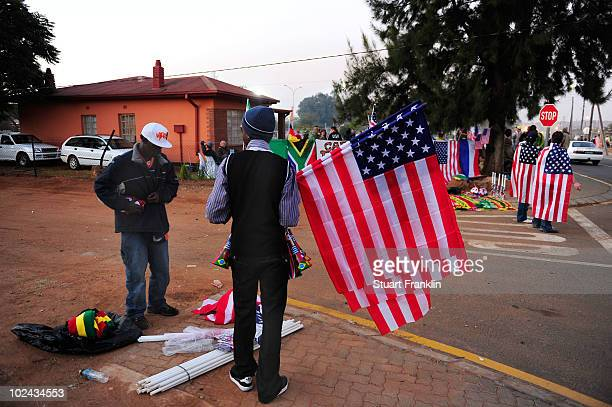 A vendor sells American flags in the area outside the Royal Bafokeng Stadium ahead of the 2010 FIFA World Cup South Africa Round of Sixteen match...