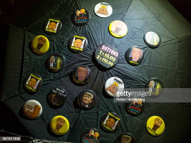 Vendor sells anti-Trump pins across the street from Trump Tower December 18, 2017 in New York City. Tourism along 5th Avenue near Trump Tower has...