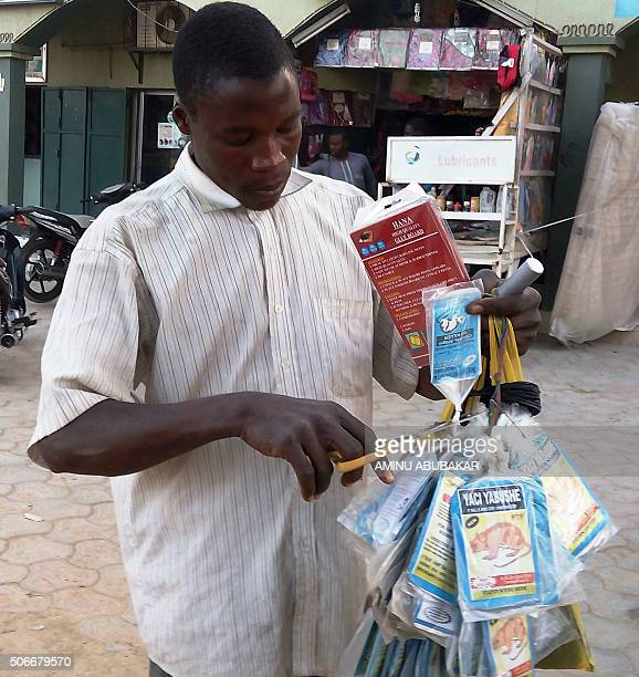 A vendor sells bags of rat poison in northern Nigeria's largest city of Kano on January 18 2016 Sales of rat poison have taken off in Nigeria...