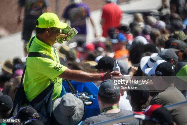 A vendor sells beer during the DENSO Spark Plugs NHRA FourWide Nationals Sunday April 8 at The Strip at Las Vegas Motor Speedway in Las Vegas NV