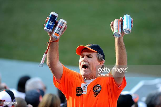 A vendor sells beer during the game between the Baltimore Orioles and the Minnesota Twins during the home opener at Oriole Park at Camden Yards on...