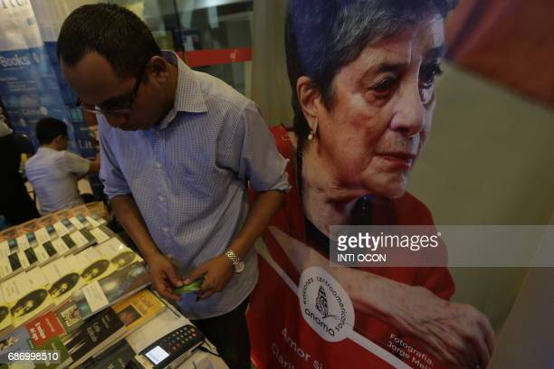 A vendor sells books by Claribel Alegria winner of the Reina Sofia of Poetry award during the fifth literary festival CentroAmérica Cuenta dedicated...