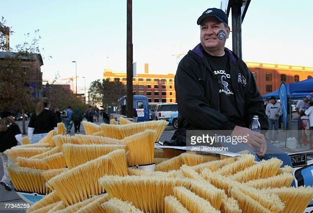 A vendor sells brooms outside of Coors Field before Game Four of the National League Championship Series between the Colorado Rockies and the Arizona...