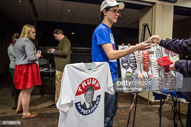 A vendor sells buttons and tshirts ahead of a rally with Republican presidential candidate Donald Trump at the Ramada Waterloo Hotel and Convention...