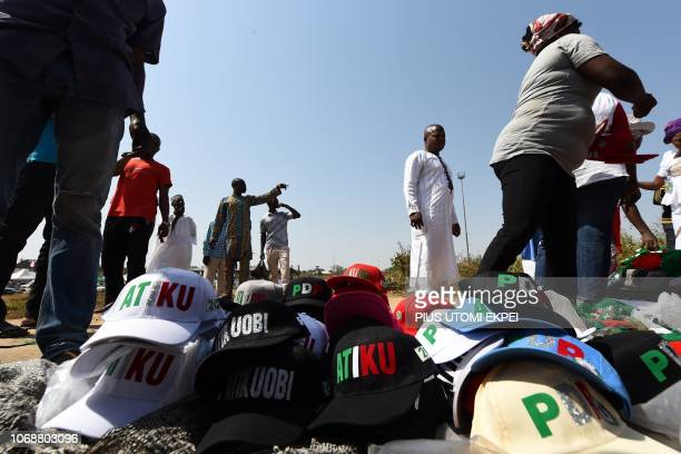 A vendor sells cap reading Atiku the name of presidential candidate of the Nigeria's opposition party Peoples Democratic Party Atiku Abubakar during...