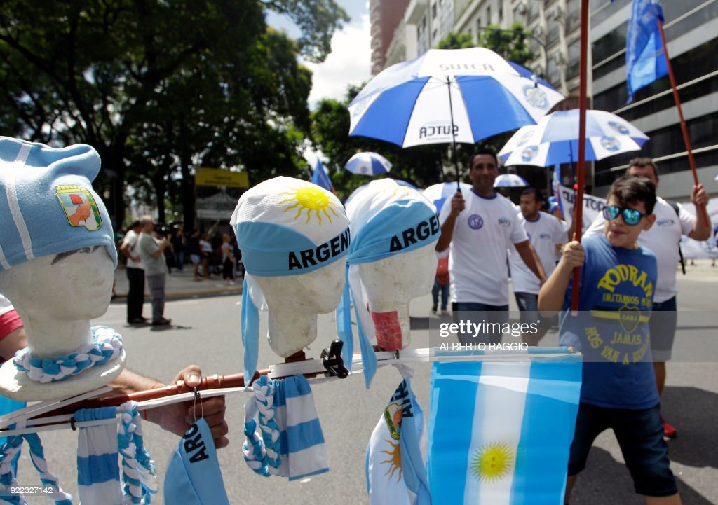 A vendor sells caps and flags as Argentine truckers and other labor unions and social organizations protest austerity measures adopted by the government of Mauricio Macri, in a demonstration in Buenos Aires on February 21, 2018. /