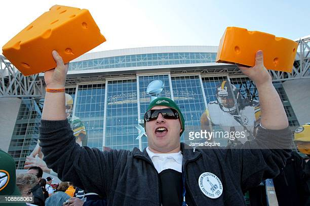A vendor sells cheese head hats for Green Bay Packers fans before they play against the Pittsburgh Steelers in Super Bowl XLV at Cowboys Stadium on...