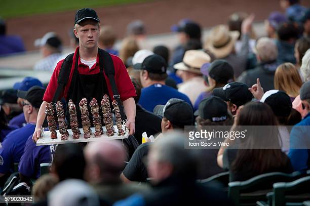 A vendor sells chocolate covered strawberries to fans in the lower stands during a regular season Major League Baseball game between the San...