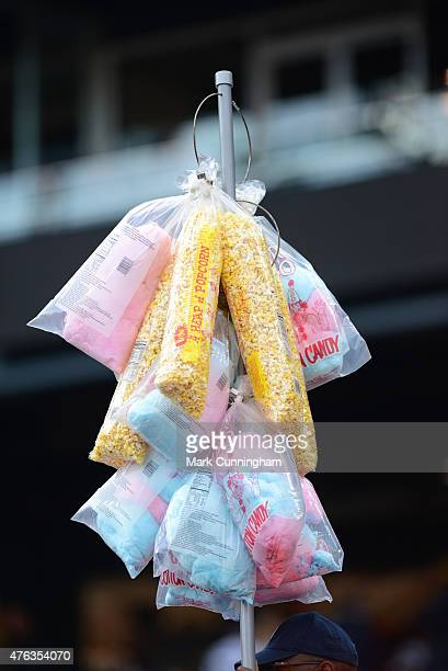 A vendor sells cotton candy and popcorn in the stands during the game between the Detroit Tigers and the Oakland Athletics at Comerica Park on June 2...