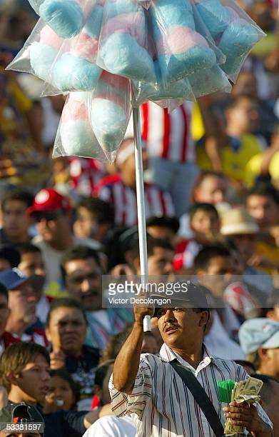 A vendor sells cotton candy to soccer fans prior to the two matches between Chivas USA and the Los Angeles Galaxy of the MLS and the friendly between...