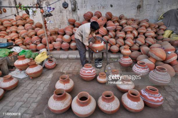 Vendor sells empty earthen pots for storing water, at Sanjay Colony in Okhla Phase II, on June 11, 2019 in New Delhi, India. The city has been facing...