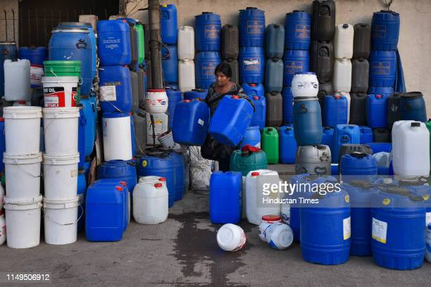 Vendor sells empty jerrycans and water containers, at Sanjay Colony in Okhla Phase II, on June 11, 2019 in New Delhi, India. The city has been facing...