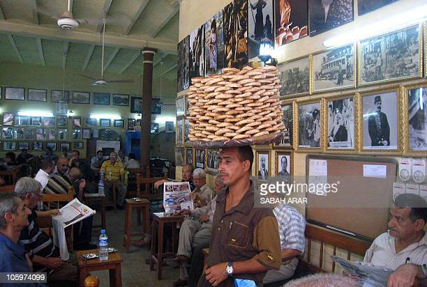 A vendor sells flat bread as Iraqis gather at Shah Bandar cafe in Baghdad on October 23 2010 to discuss the Wikileaks revelations which contain...