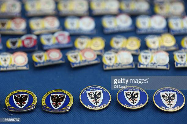 A vendor sells football pin badges outside AFC Wimbledon's stadium before the npower League Two match between AFC Wimbledon and Aldershot Town at the...