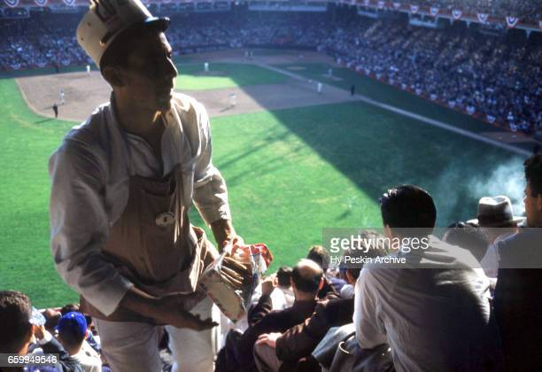 A vendor sells Frankfurter hotdogs for twenty cents during the 1953 World Series with the New York Yankees and Brooklyn Dodgers circa October 1953 at...