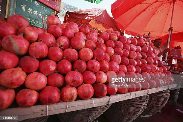 Vendor sells fruits at a market on September 22, 2006 in Kashi of Xinjiang Uygur Autonomous Region, northwest China. Kashi is an oasis city which has...