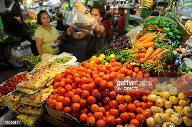 A vendor sells meat at a market in Manila on March 4 2011 The Philippines said inflation had risen at a fasterthanexpected pace of 43 percent in...