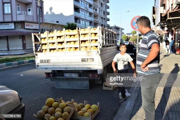 A vendor sells melons on the street on the third day of Eid alAdha in southern Hatay province of Turkey on August 23 2018 Hatay is bordered by Syria...