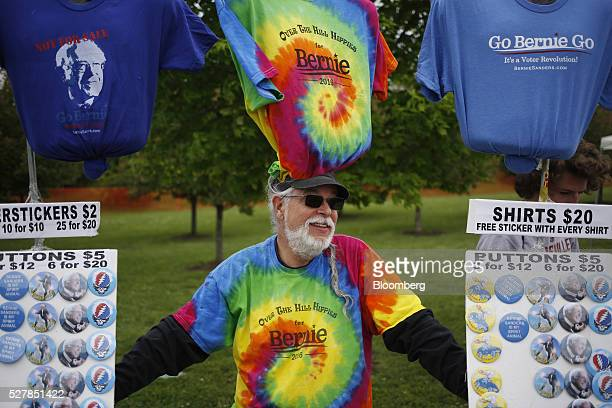 A vendor sells merchandise outside a campaign event for Senator Bernie Sanders an independent from Vermont and 2016 Democratic presidential candidate...