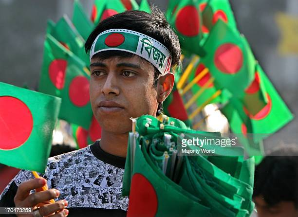A vendor sells National flag during 'Victory Day' celebrations at the National Memorial in Saver on the outskirts of Dhaka Bangladesh December 16 2007