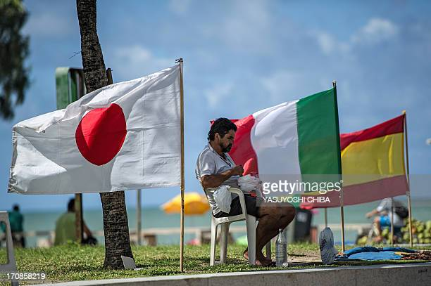 A vendor sells national flags at Boa Viagem beach in Recife northeast of Brazil on June 19 2013 as the FIFA Confederations Cup Brazil 2013 football...