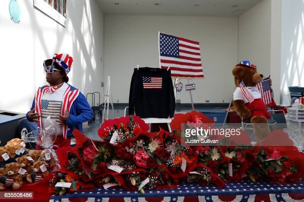 A vendor sells patriotic merchandise during a naturalization ceremony held by US Citizenship and Immigration Services at the Los Angeles Convention...
