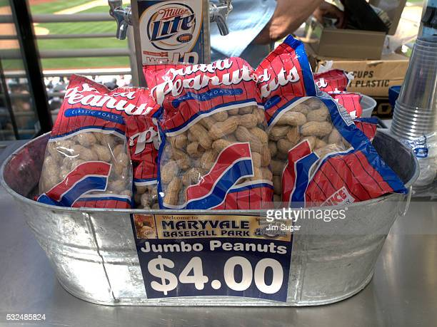 A vendor sells peanuts during a spring training game between the Milwaukee Brewers and Colorado Rockies