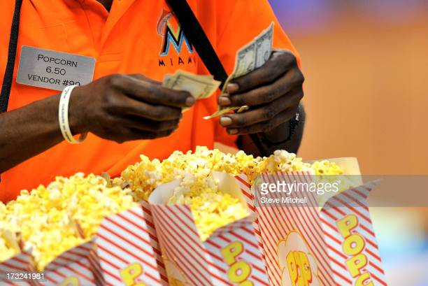 A vendor sells popcorn during a game between the Atlanta Braves and the Miami Marlins at Marlins Park on July 8 2013 in Miami Florida
