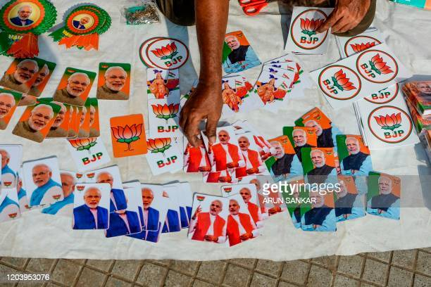 A vendor sells portraits of India's Prime minister Narendra Modi during a protest by supporters of the Bharatiya Janata Party in support of the...