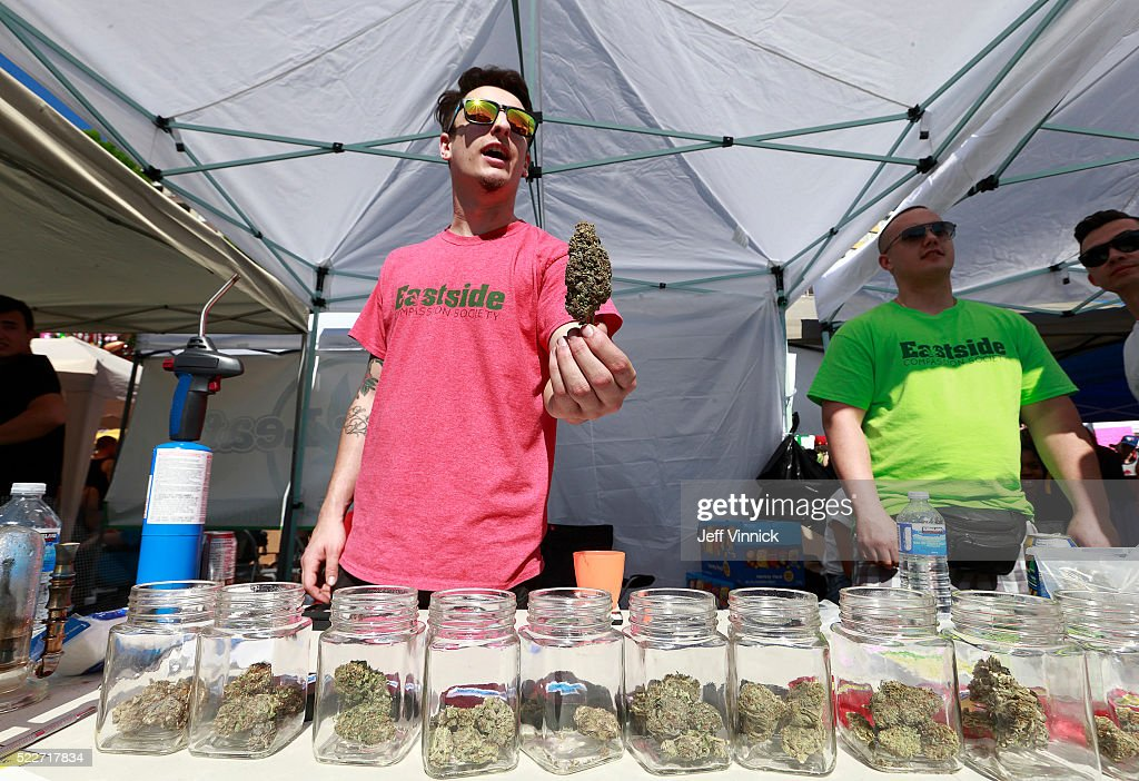 A vendor sells pot as thousands of people gather at 4/20 celebrations on April 20, 2016 at Sunset Beach in Vancouver, Canada. The Vancouver 4/20 event is the largest free protest festival in the city, with day-long music, public speakers and the world's only open-air public cannabis farmer's market where people sell all kinds of cannabis and extracts while educating the crowd about medical marijuana, political involvement and activism. Canadian Federal Health Minister Jane Philpott says Canada will roll out the legislation in the spring of 2017 to begin the process of legalizing and regulating marijuana.