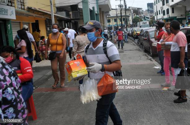 A vendor sells products including gloves and vitamins to fight the novel coronavirus COVID19 in downtown Guayaquil Ecuador on April 15 2020 Guayaquil...