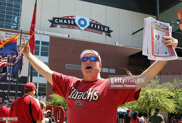 A vendor sells programs for the Opening Day major league baseball game between the San Diego Padres and the Arizona Diamondbacks at Chase Field on...