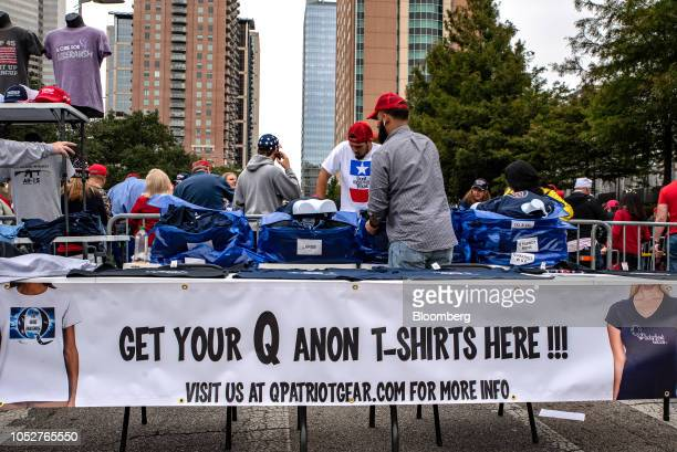 A vendor sells Qanon shirts ahead of a rally with US President Donald Trump and Senator Ted Cruz a Republican from Texas in Houston Texas US on...