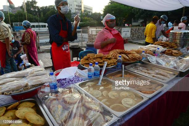 Vendor sells rice made local cakes at the celebration ''Nabanna Festival'' in Dhaka, Bangladesh, on November 16, 2020. ''Nabanna'' or the new time...