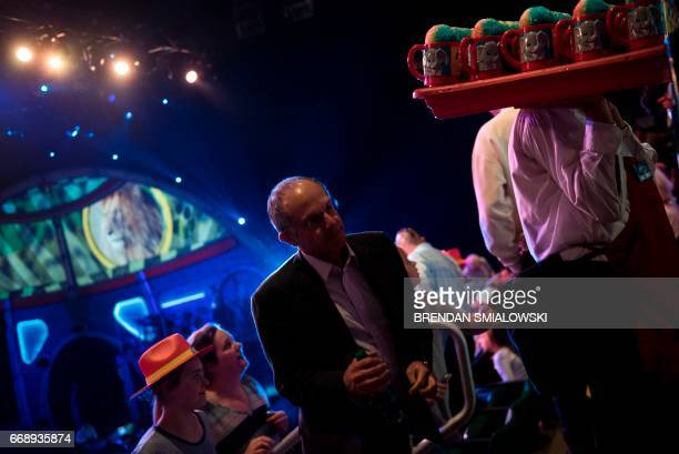 A vendor sells shaved ice during an intermission of the Ringling Brothers and Barnum Bailey Circus at Eagle Bank Arena April 14 2017 in Fairfax...