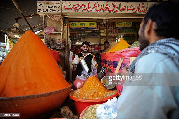 A vendor sells spices at a market in Rawalpindi Pakistan on Sunday Dec 30 2012 Pakistan's economy will probably expand 35 percent in the 12 months...