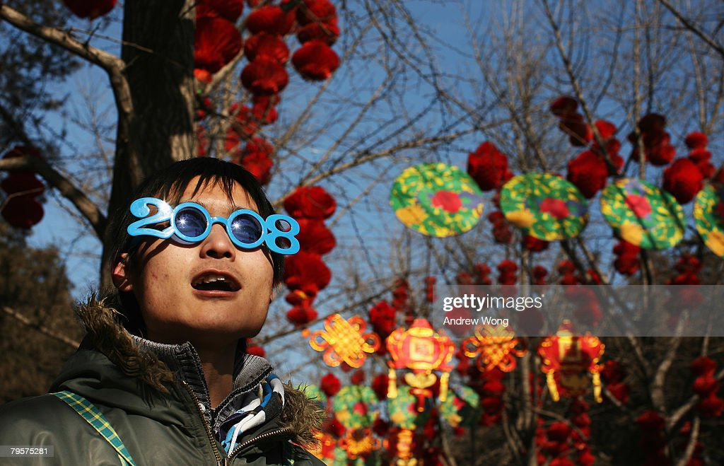 chinese new year celebration10 pictures embed embedlicense a vendor sells sunglasses in the shape of 2008 at the ditan temple fair on february - Chinese New Year 2008