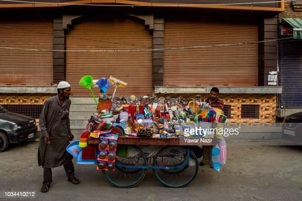 A vendor sells utensils on a cart on September 16 2018 in Srinagar the summer capital of Indian administered Kashmir India Kashmir the Muslim...