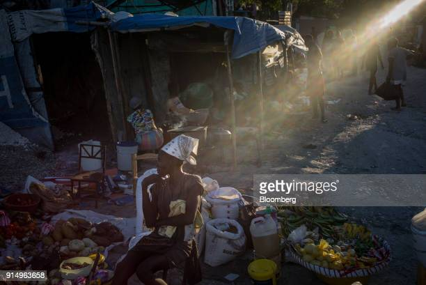 A vendor sells vegetables at the Caradeux refugee camp set up after the 2010 earthquake in PortAuPrince Haiti on Monday Jan 29 2018 Billions of aid...