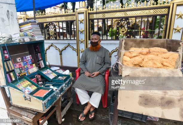 Vendor sells vermicelli and Attar, waiting for customer on the eve of Eid al-Fitr, during the ongoing COVID-19 nationwide lockdown, in Guwahati,...