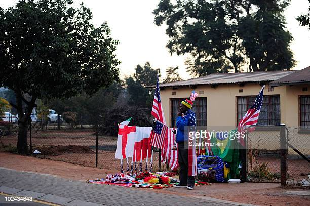 A vendor sells vuvuzelas and American flags in the surrounding area near to the Royal Bafokeng Stadium ahead of the 2010 FIFA World Cup South Africa...