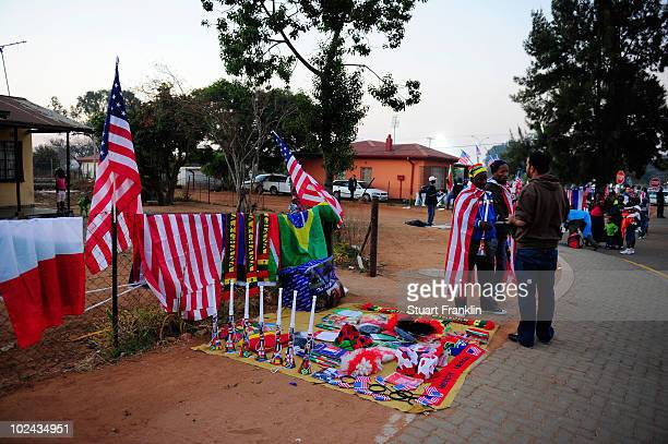 A vendor sells vuvuzelas and American flags outside the Royal Bafokeng Stadium ahead of the 2010 FIFA World Cup South Africa Round of Sixteen match...