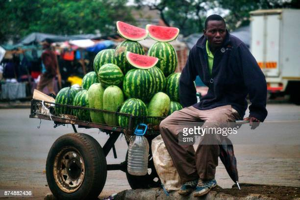 A vendor sells watermelons at a marketplace in the Mbare suburb of Harare on November 16 a day after the military took power and announced plans to...