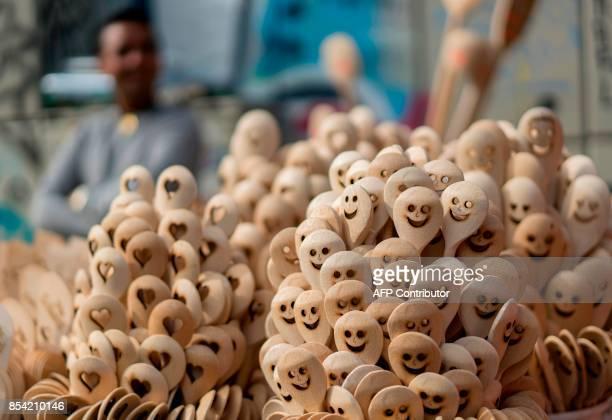 A vendor sells wooden spoons at Naschmarkt market in Vienna Austria on September 25 2017 / AFP PHOTO / JOE KLAMAR
